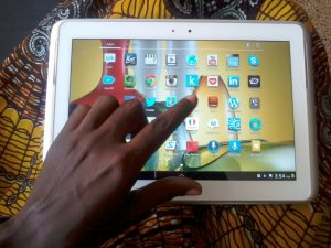 Ghanaian_using_a_tablet